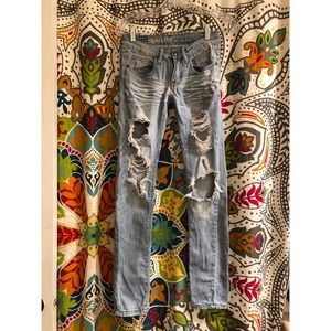 MACHINE light wash distressed holed skinny jeans